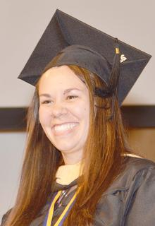 Chellsey Phillips of Campbellsville smiles as she receives her Master of Social Work degree.