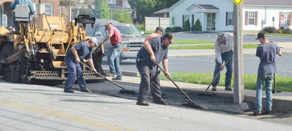 Workers from Brady Paving in Lebanon spread blacktop near the entrance to Winters Dining Hall.