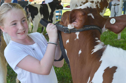 Sidney Jones of Greensburg smiles as her entry in the dairy show is judged.
