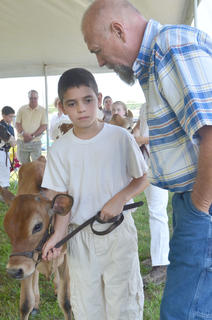 Dale Turner Jr. of Mercer County gives Hadey Alabusalim of Campbellsville feedback during the dairy show.