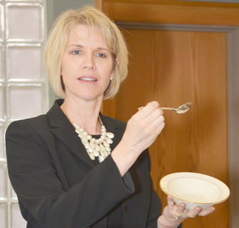 Terri Thompson of The Etiquette Edge in Paris, Ky., explains the proper way to eat soup.