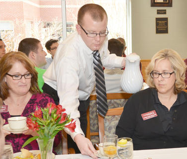 Chris Baker, service/banquet manager with Pioneer Foods, collects dishes from Teresa Elmore, director of career services at CU, at left, and Leigh Ann Sadler, secretary in the Office of Academic Support at CU.