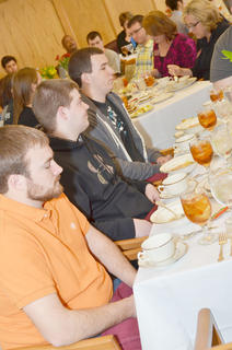 From left, students James Hogue, David Raley and Matt Martin are instructed on how to properly eat soup.