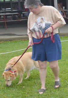 Cindy Drake of Campbellsville walks her dog Angel around the track at the Taylor County SPCA's annual dog show on Sunday.