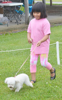 Claudia Garner of Campbellsville leads her dog Angel around the track at the Taylor County SPCA's annual dog show on Sunday.