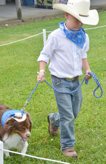 Jacob Johnson of Campbellsville gives his dog Whiskey a treat during the Taylor County SPCA's annual dog show on Sunday. Whiskey was named the grand champion winner at the show.