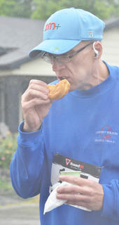 Terry Holmes eats one of the nine donuts he ate during the race. He ate the most donuts out of all 58 runners and walkers.