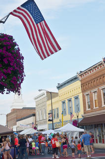 The American flag sways in the breeze over downtown Campbellsville on Thursday evening.