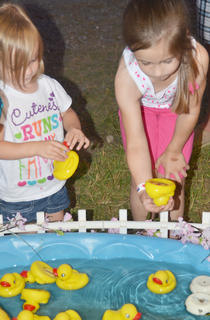 Katie Brumagen, 2, at left, and her sister, Karry, of Paris, Ky., take their chances at the duck pond game.