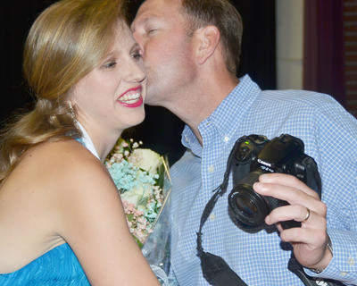 Kassie Miller, Taylor County's Distinguished Young Woman for 2015, gets a kiss on the cheek in congratulations from her father, John.