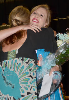 Kassie Miller, Taylor County's Distinguished Young Woman for 2015, gets a hug in congratulations from her mother, Shelly.
