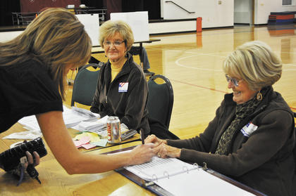 Stephanie Moss signs in at her precinct Tuesday afternoon.