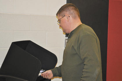Chad White scans his ballot.
