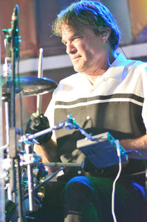 Steve Goetzman plays drums for Exile.