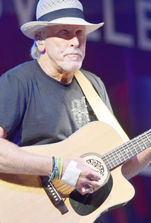 Les Taylor plays guitar with Exile.