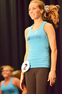 Hannah Howard, who was named first runner-up, smiles during the fitness routine.
