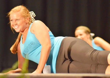 Taylor Smoot, who was named the spirit award winner, smiles for the judges during the fitness routine.