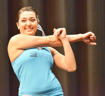 Rachel Hinton, who won the talent award and was named second runner-up, smiles as she participates in the fitness portion of the program.