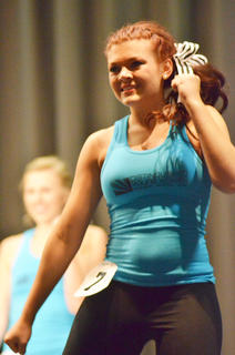 Tori Cochran smiles as she performs the fitness routine.