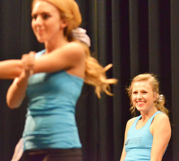 Kassie Miller, who was named the 2015 Taylor County Distinguished Young Woman, smiles as she performs the fitness routine. Miller also took home the scholastic, self-expression and interview awards.