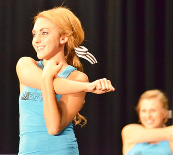 Savannah Nolley smiles for the judges during the fitness portion of the program.