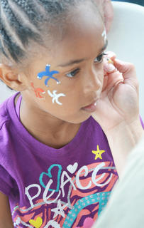Amina Vazquez asked for fireworks to be painted on her face at the Family Fun Zone. Vazquez, 7, comes to Campbellsville from Georgia every year to visit family members and attend the community's annual Fourth of July celebration.