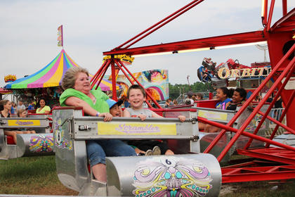 Lois Brown, Remy Brown, middle, and Bailey Stearman hold on tight while riding the Scrambler.