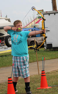 Noah Mardis aims for the bull's eye while participating in On Target for Christ Archery.