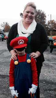 Kim Richerson poses with Isaiah White, dressed as Mario at Muldraugh Hill Baptist Church's Trunk or Treat on Wednesday, Oct. 30.