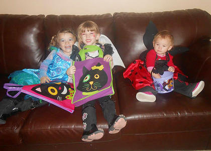 Leilah, Liana, and Lillynn getting ready to go trick-or-treating.
