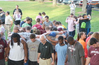 Hundreds of Campbellsville University students, faculty and staff members, and many members of the Taylor County community, came together on Thursday night to pray for the firefighters who were injured. Students read scripture and sang.