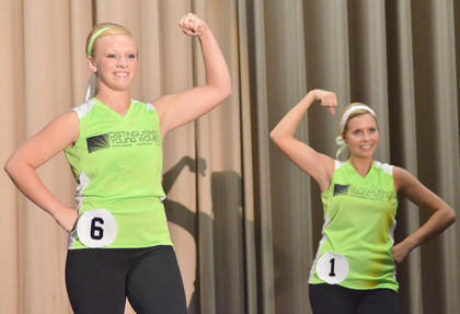 Kori Richerson, at left, and Becca Orberson, who was named first runner-up, show off their muscles in the fitness portion of the competition.