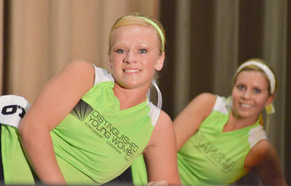 Kori Richerson smiles as she does a floor fitness routine. In back is Becca Orberson, who was named first runner-up.