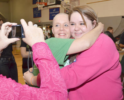 Gina Leigh is one of several women who shaved their heads on Saturday at the annual St. Baldrick's event at Campbellsville University to raise money for children's cancer research. Leigh shaved in honor of Sara Knifley, at right, a member of her youth group who has battled cancer.