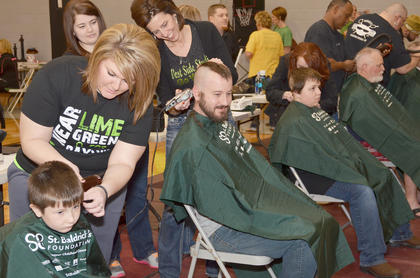 Six groups of people, including men, women and children, got their heads shaved on Saturday.