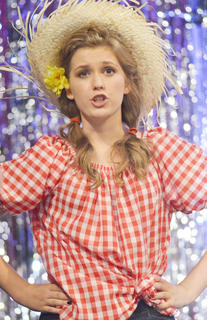 Callie Botkin sings and dances during a musical number.