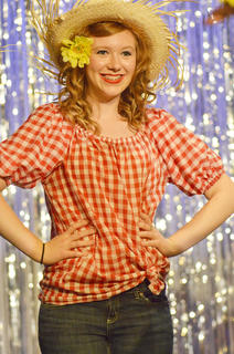 Hannah Lanham sings and dances during a musical number.