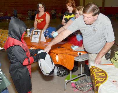 Taylor County Sheriff Allen Newton passes out candy at the annual Halloween Bash at Taylor County Elementary School. The event was hosted by Q-104 and local emergency services personnel.