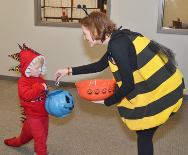 Windy and rainy weather couldn't keep the goblins, princesses and superheroes from trick-or-treating on Main Street, at the public library and at the annual Halloween Bash on Halloween. While the threat of inclement weather delayed the community's door-to-door trick-or-treating until Nov. 2, other events went as scheduled. Above, Taylor County Public Library Director Julia Turpin passes out candy to Benjamin Parrott, 3, of Campbellsville.