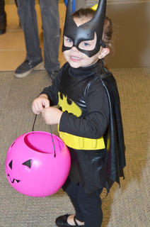 Batgirl smiles after she gets some candy at the library.