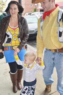"""Kendall Graham, 2, and Whitney Coile, at left, and Cory Graham, all of Campbellsville, dress as characters from """"Toy Story"""" as they trick-or-treat on Main Street."""