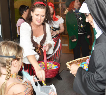 Citizens Bank and Trust Co. employees dress the part as they hand out candy during trick-or-treating on Main Street.