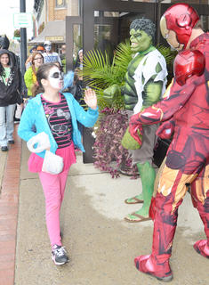 Citizens Bank and Trust Co. employees dress as superheroes and greet children on Main Street.
