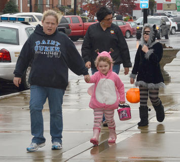 The rain couldn't keep trick-or-treaters away from Main Street. Participating downtown businesses passed out candy Thursday afternoon.