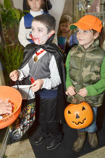 Children ask for candy while trick-or-treating on Main Street.
