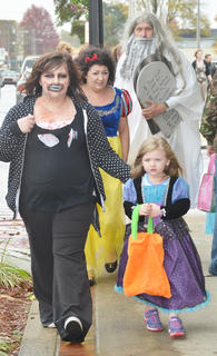 Children weren't the only ones wearing costumes on Main Street last Thursday. Adults dressed the part too.