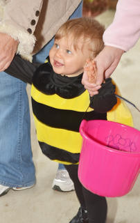 Jordan Kate Jones, 14 months, dresses as a bee for her first Halloween. Jones was one of hundreds of children who trick-or-treated on Main Street.