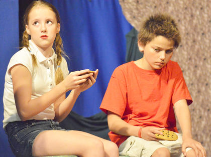 Riley Phillips, at left, plays Gretel and Robert Billeter is Hansel.