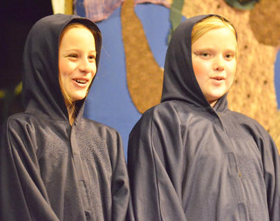 "Catherine Allen, at left, and Olivia Herron smile as they sing during ""Hansel and Gretel."""