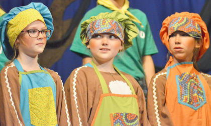 From left, Sophie McAnelly, Olivia Herron and Baylie Skaggs portray the witch's cooks.